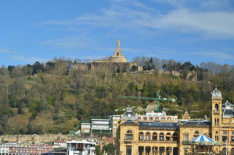 View Of Mount Urgull With Christ Of Urgull Blessing San Sebastian On Foot Of Photo San Sebastian Town Hall. Architecture Travel Na stock photos