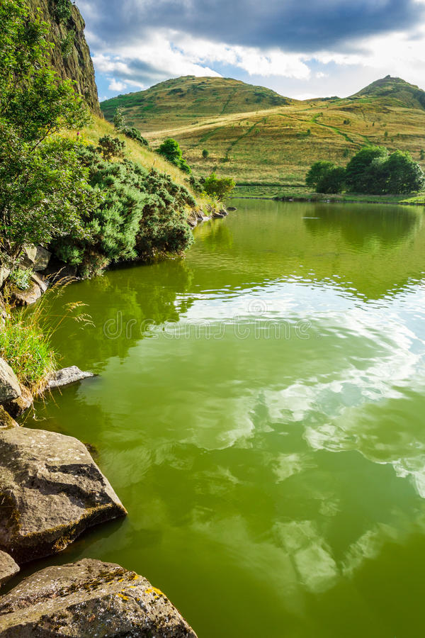 View of a mountain lake at the saint Patrick Day's stock photo