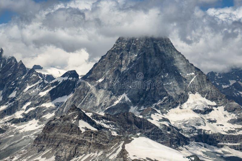 A view on mountain Matterhorn in clouds stock photos