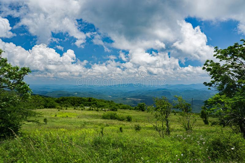View From a Mountain Meadow on Top Whitetop Mountain, Grayson County, Virginia, USA. View from a Mountain Meadow with Mountains in the background from the Top of royalty free stock photos