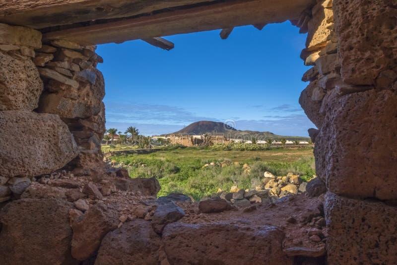 View of mountain through ruin in La Oliva Fuerteventura Las Palmas Canary Islands Spain royalty free stock photo