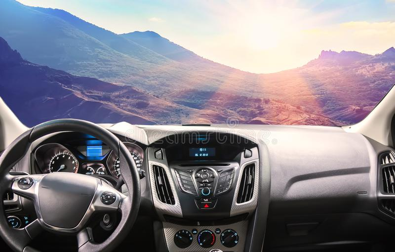 View of the mountain scenery from the car through the windshield. View of the beautiful mountain scenery from the car through the windshield royalty free stock images