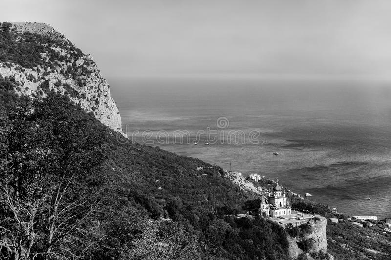 View of the mountain, sea and church on a rock, bw. stock image