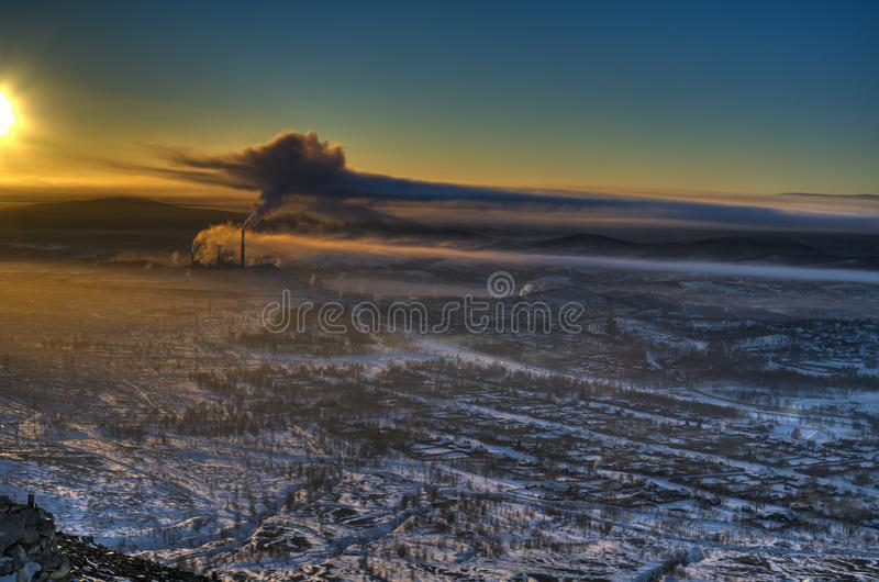 View from the mountain to the evening panorama of the city of Karabash. The city of Karabash Chelyabinsk region, South Ural is perhaps the most ecologically royalty free stock images
