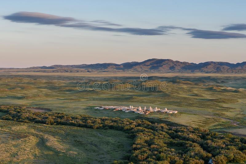 The view from the mountains to the steppe and the traditional Asian cemetery. royalty free stock photography