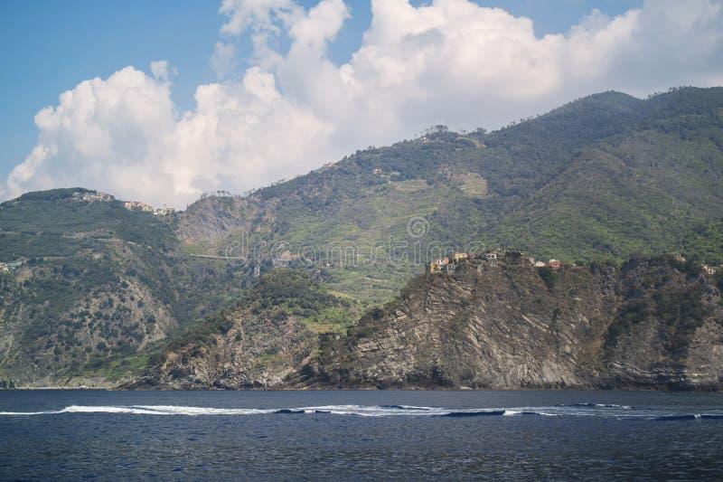 View of the mountain village of Corniglia, Cinque Terra from the sea. Liguria, Italy, Europe. Seascape of Mediterian sea stock images