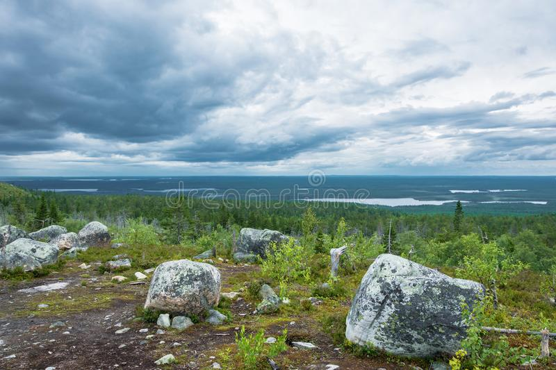 View from mountain Vottovaara, Karelia. View from the mountain Vottovaara is the highest peak in the reserve on a cloudy day, Karelia, Russia royalty free stock photography
