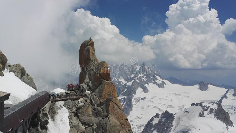 View of mountaineers climbing on a rock near the Aiguille du Midi in the Mont Blanc massif, France, Europe stock image