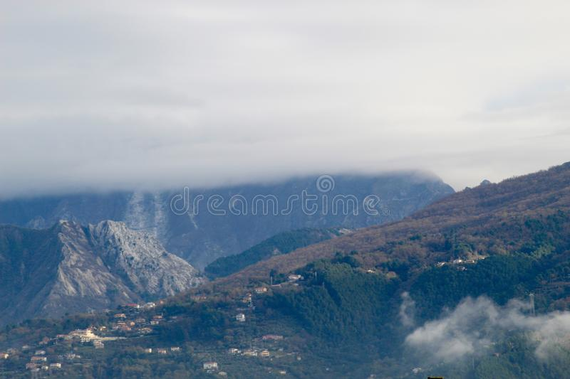 The view of the mountains. These are the mountains , the Alps in Italy at a sunny but also cloudy day stock photo