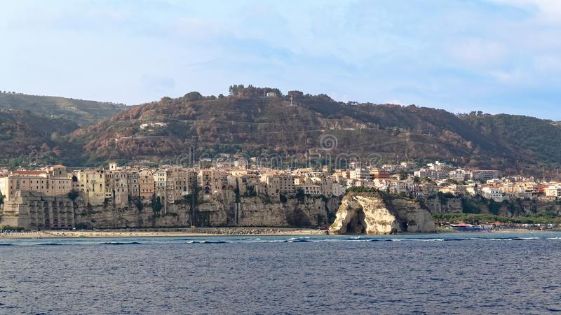 View of the houses of Tropea from tyrrhenian sea. View of the mountains and buildings of Tropea from Tyrrhenian sea, from a touristic ship royalty free stock image