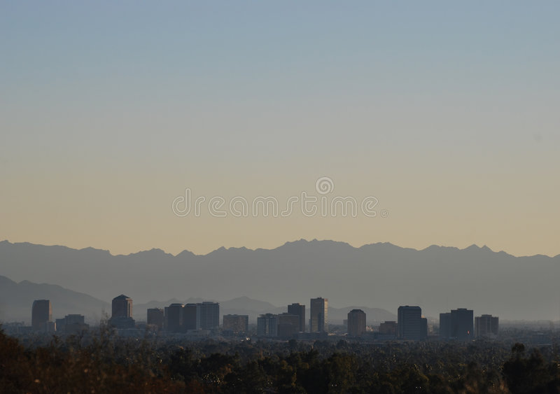View of mountains and downtown Phoenix area, Arizona. Downtown Phoenix at sunset, Arizona, United States royalty free stock photography