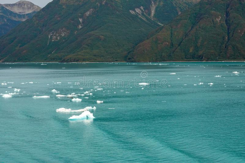A view of mountains and icebergs in the Wrangell National Park outside of Hubbard Glacier Alaska from a cruise ship. View of mountains and icebergs in the stock photos