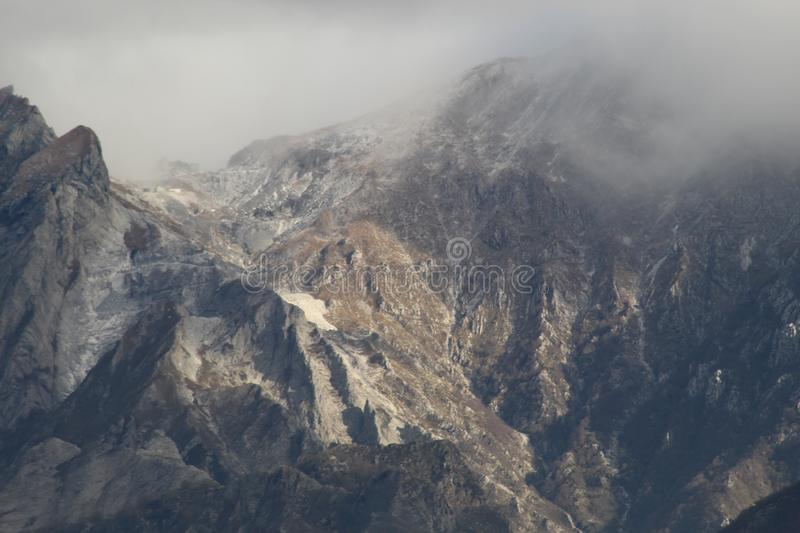 The view of the mountains. These are the mountains , the Alps in Italy at a sunny but also cloudy day royalty free stock images