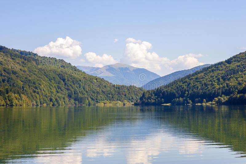 View of mountains in summer with lake in front royalty free stock images