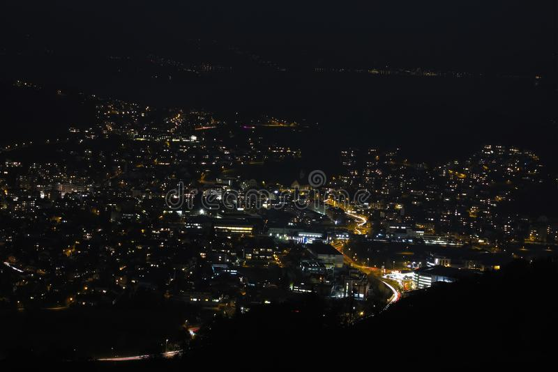 View from the mountains to the night city of Lucerne in Switzerland stock images