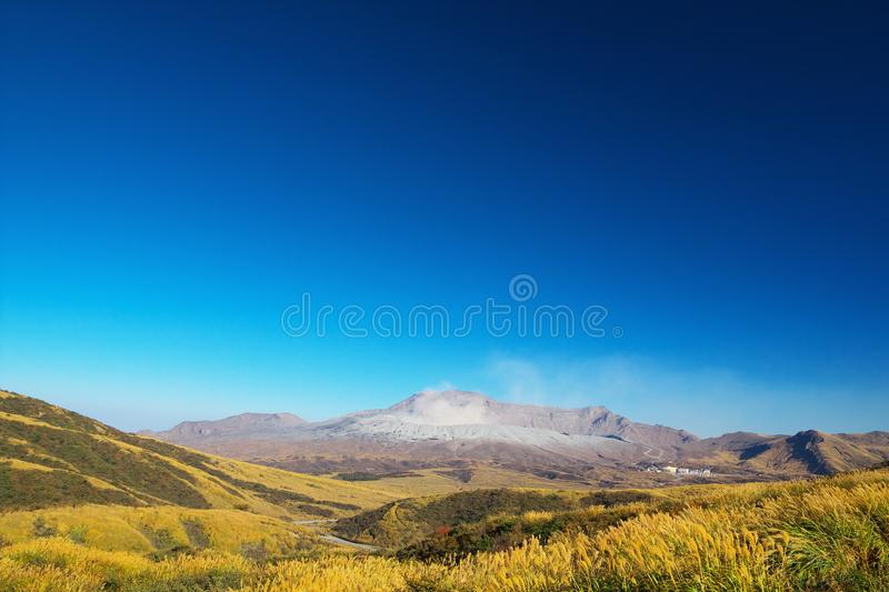View of Mt. Aso which is spewing smoke at Autumn. An image of nature royalty free stock images