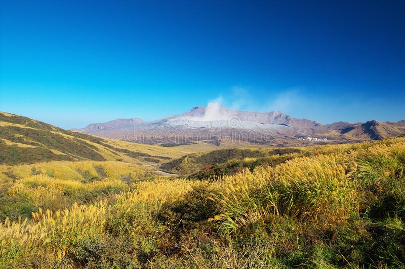 View of Mt. Aso which is spewing smoke at Autumn. An image of nature stock photo