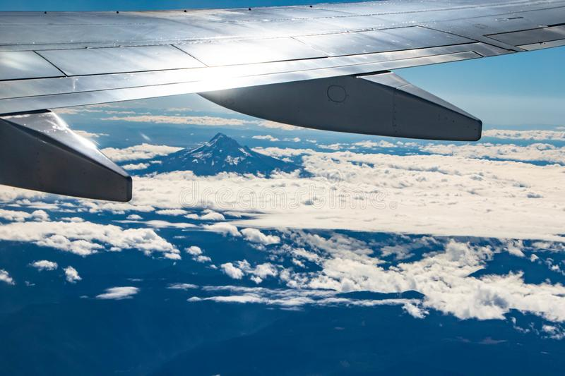 A view of Mt. Hood from an airplane window royalty free stock images