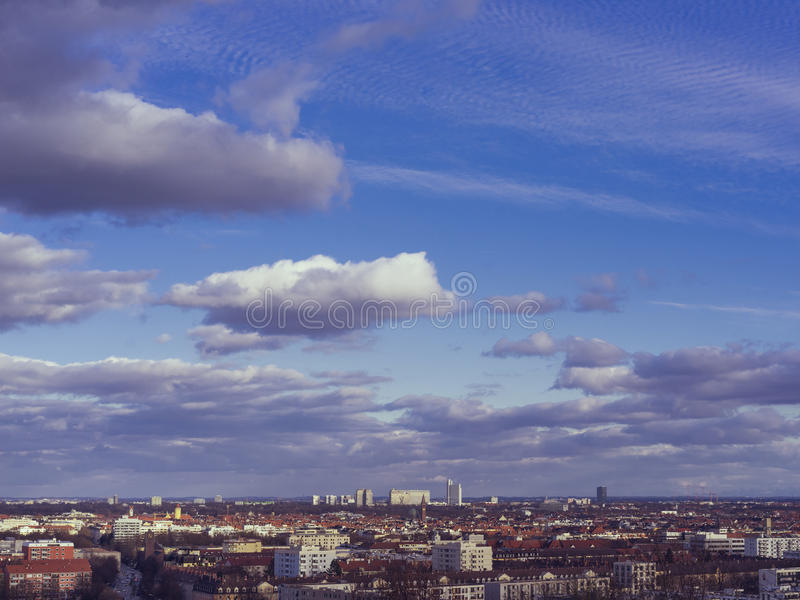View of Munich Skyline with clouds from Olympia Park Munich, Ba royalty free stock photography
