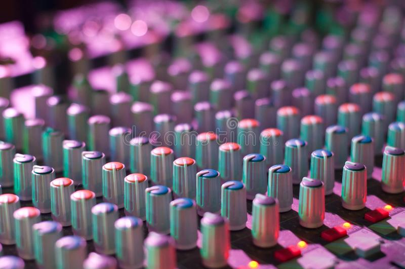 View of music mixer in concert, filled with lights. Detail view of music mixer in concert, filled with lights royalty free stock photos