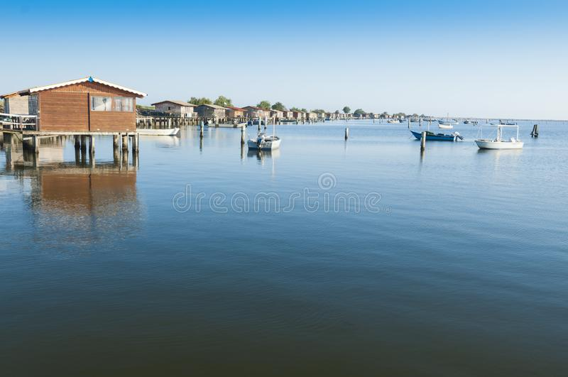 Mussel cultivation boats, at Scardovari lagoon, Po& x27; river delta,. View of a Mussel Cultivation area at the Scardovari Lagoon, Po river estuary, Rovigo royalty free stock photos