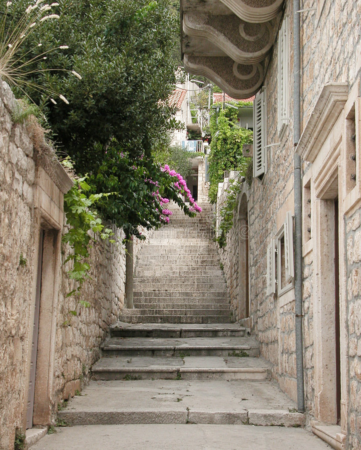 A view of a narrow alley. In city of Hvar, on island Hvar, Croatia royalty free stock photography