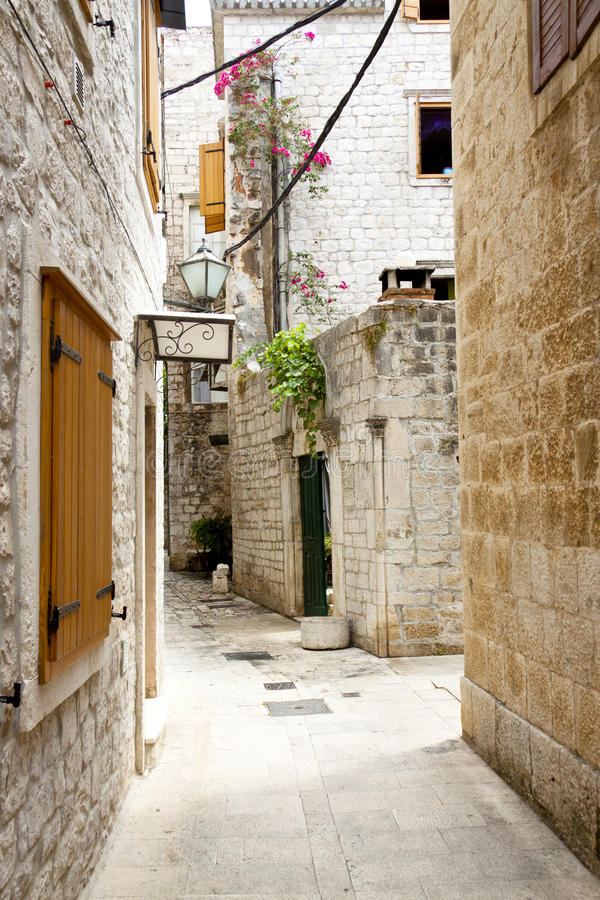 View on narrow alley - Trogir, Croatia. stock photos