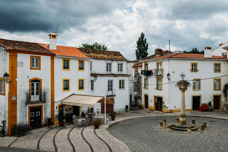 View of narrow main square consisting of limestone cozy yellow and white houses at Constancia in the Santarem District. Of Portugal stock photo