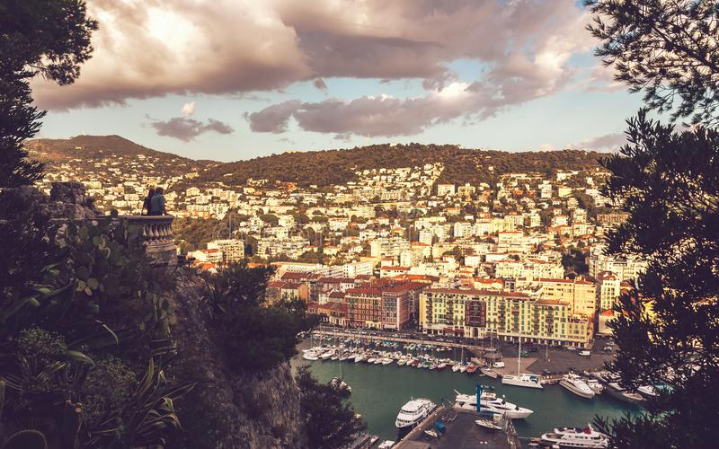 Port Lympia and Mont-Boron viewed from Castle Hill. Unidentified people observing Port Lympia with yachts and boats from viewpoint on Castle Hill in Nice, Cote d stock photos