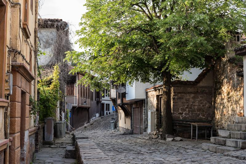 View of a narrow street in  historical part of  Plovdiv Old Town. Typical medieval colorful buildings. Bulgaria stock photography