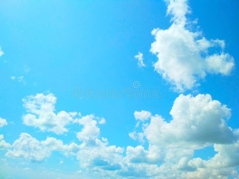 Cumulus clouds peacefully floating in the sky. View of a natural background, wool pack clouds that are peacefully floating in the sky stock photography
