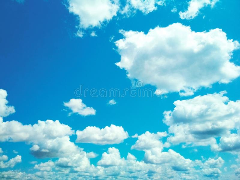 Cumulus clouds peacefully floating in the sky. View of a natural background, wool pack clouds that are peacefully floating in the sky stock image