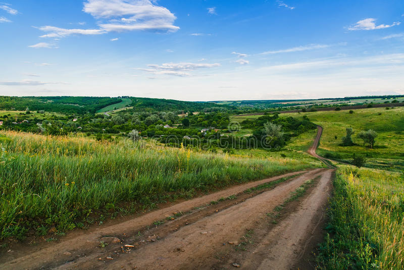 View nature from hill, old country side road. stock image