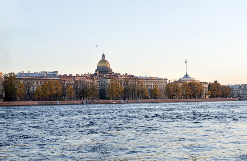 view of the Neva river embankment, the dome of St. Isaac's Cathedral, St. Petersburg at sunset stock photos