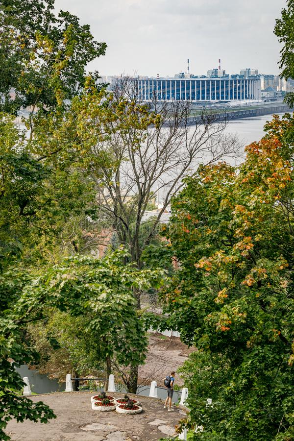 View of the new football stadium. Viewpoint in the historical part of Nizhny Novgorod. View of the famous futbol stadium. In Nizhny Novgorod through the trees royalty free stock images
