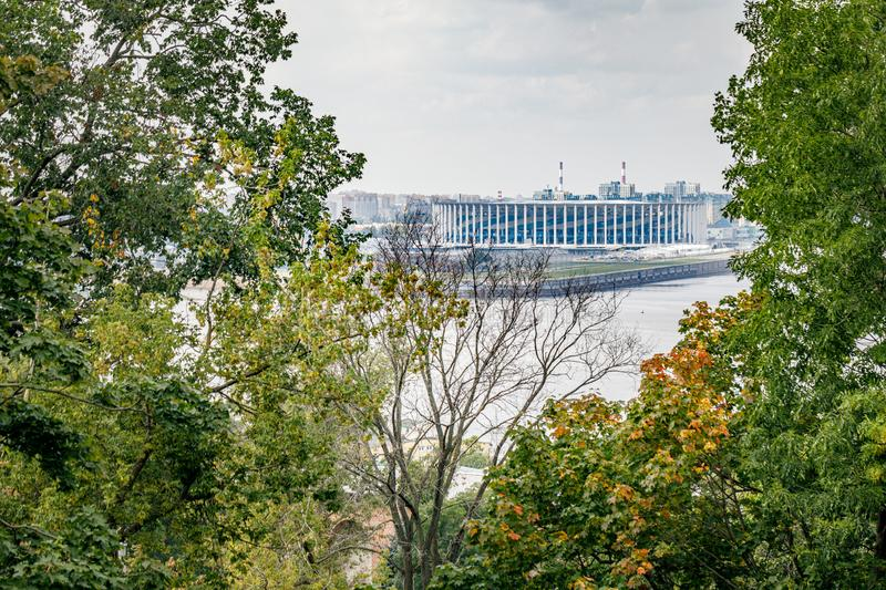View of the new football stadium. Viewpoint in the historical part of Nizhny Novgorod. View of the famous futbol stadium. In Nizhny Novgorod through the trees stock photography