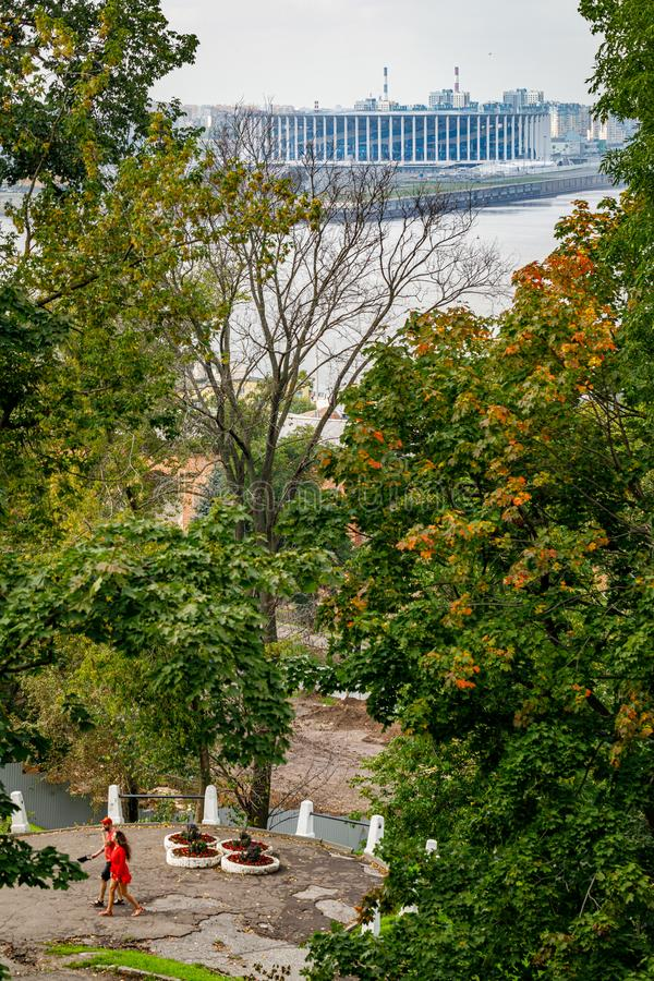 View of the new football stadium. Viewpoint in the historical part of Nizhny Novgorod. View of the famous futbol stadium. In Nizhny Novgorod through the trees stock photo
