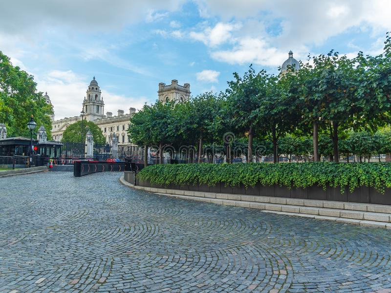The New Palace Yard and the garden of the Westminster Palace and the Houses of Parliament, London, UK. View of the New Palace Yard and the garden of the royalty free stock images