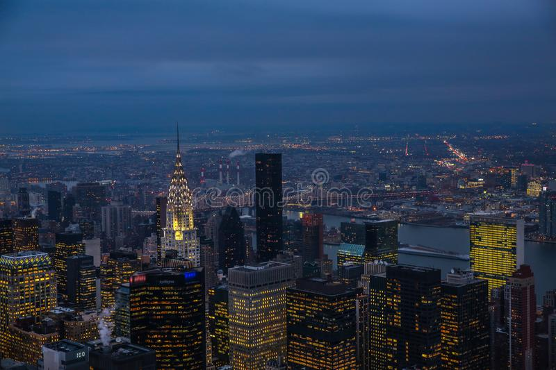 View on New York City skyline at night with manhattan bridge in the back. Blurry royalty free stock photography