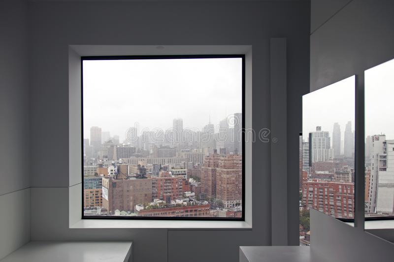 A view of New York City skyline from a window and a reflection on the mirror royalty free stock photo