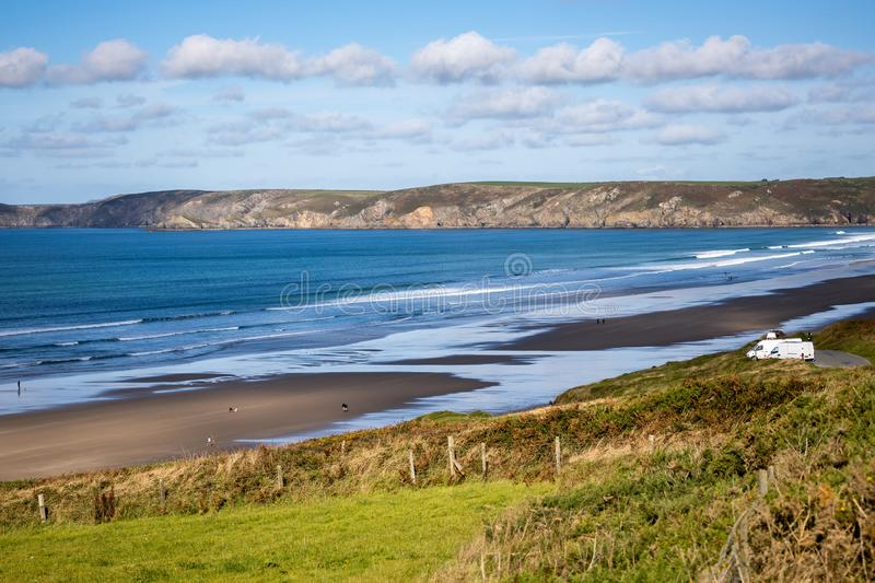 View of Newgale beach in Pembrokeshire on September13, 2019. Unidentified people. NEWGALE, PEMBROKESHIRE/UK - SEPTEMBER 13 : View of Newgale beach in royalty free stock image