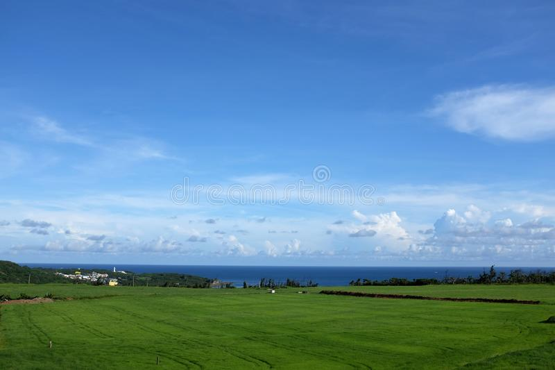 View of North Pacific and grassland in Kenting. View of ngoluanpi park beside the sea in kenting view of north pacific beside the sea in kenting, Taiwan royalty free stock image