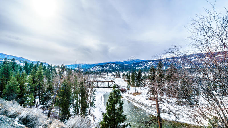 View of the Nicola River and a Steel Bridge on a cold winter day. From Highway 8 between Spences Bridge and Merritt in central British Columbia on a cold winter royalty free stock photos