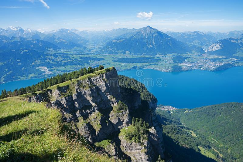 View from niederhorn mountain to lake thunersee. Bernese oberland swiss alps landscape royalty free stock photo