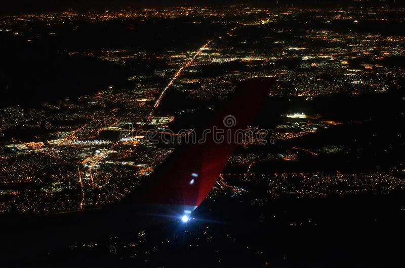 Download View Of Night City Under The Wing Airplane Stock Photo