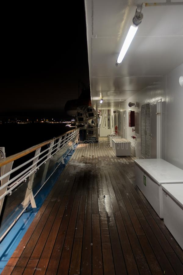 View of the night from the deck of a ship with the city seen in the horizon stock photos