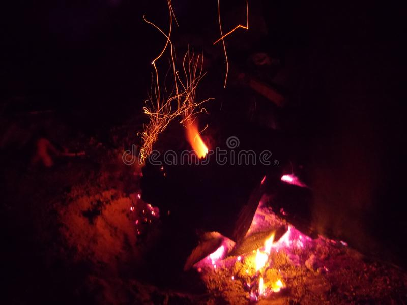 The view of the night fire. The view of the bright night fire with flashes and sparks stock images
