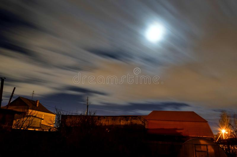 View of the night moon sky in windy cloudy weather. View of the night moon sky with fast-flying clouds in the suburbs, wind, fog royalty free stock image