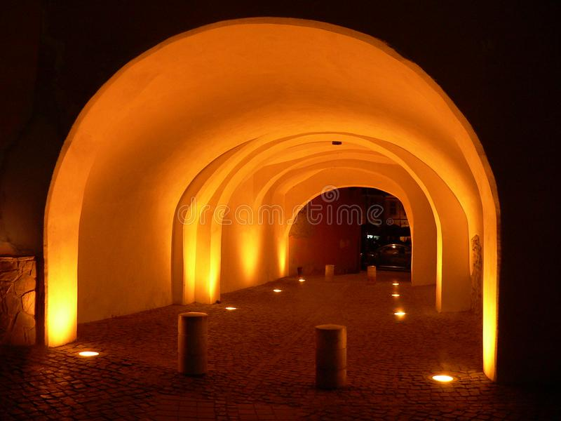 View at night of Sibiu covered street tunnel. Romania royalty free stock photo