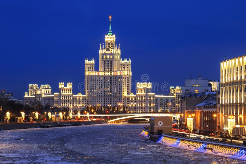 View of night winter Moscow with the Bolshoi Moskvoretsky bridge and high-rise building on Kotelnicheskaya embankment stock image